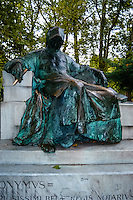 Budapest, Hungary.  Varosliget Park, The statue of Anonymus in Vajdahunyad Castle.