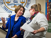 19 JANUARY 2020 - DES MOINES, IOWA: US Senator AMY KLOBUCHAR (D-MN) jokes with the person introducing her at Urban Dreams in Des Moines Sunday night. Sen. Klobuchar brought her presidential campaign to Urban Dreams, a community empowerment center in central Des Moines. Iowa hosts the first event of the presidential selection process in February. The Iowa Caucuses are Feb. 3, 2020.          PHOTO BY JACK KURTZ