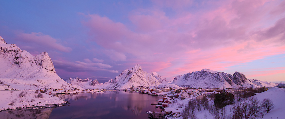 Sunrise view of Reine with Olestinden in the background.