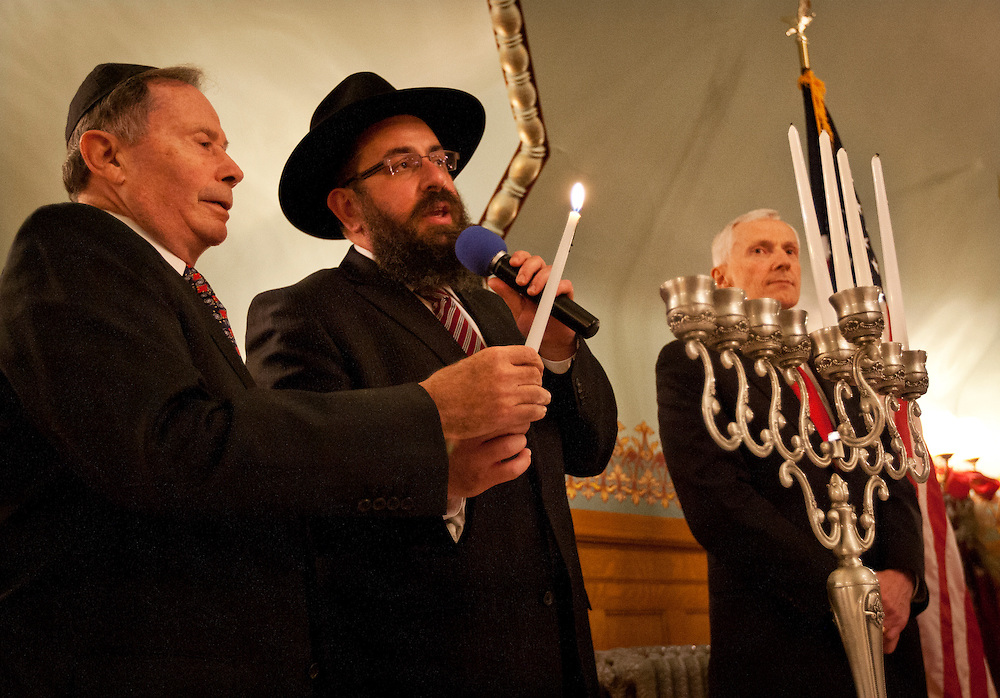 Rabbi Benny Zippel, center, and former Ambassador John Price, left, prepare to light the menorah as Lt. Gov. Greg Bell, right, looks on during the lighting ceremony at the Governor's Mansion on the fourth night of Chanukah 2012, Tuesday, Dec. 11, 2012.