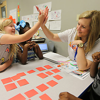 Anita McGraw, a reading teacher at SummerSalt, gives a high five to student Haley Criddle, 6, after she gets the correct vowel sounds on her words during a vowel word game in class on Monday morning. SummerSalt is a reading camp for kindergartern through thrid graders and is held at The Orchard and White Hill Baptist Church, both in Tupelo.