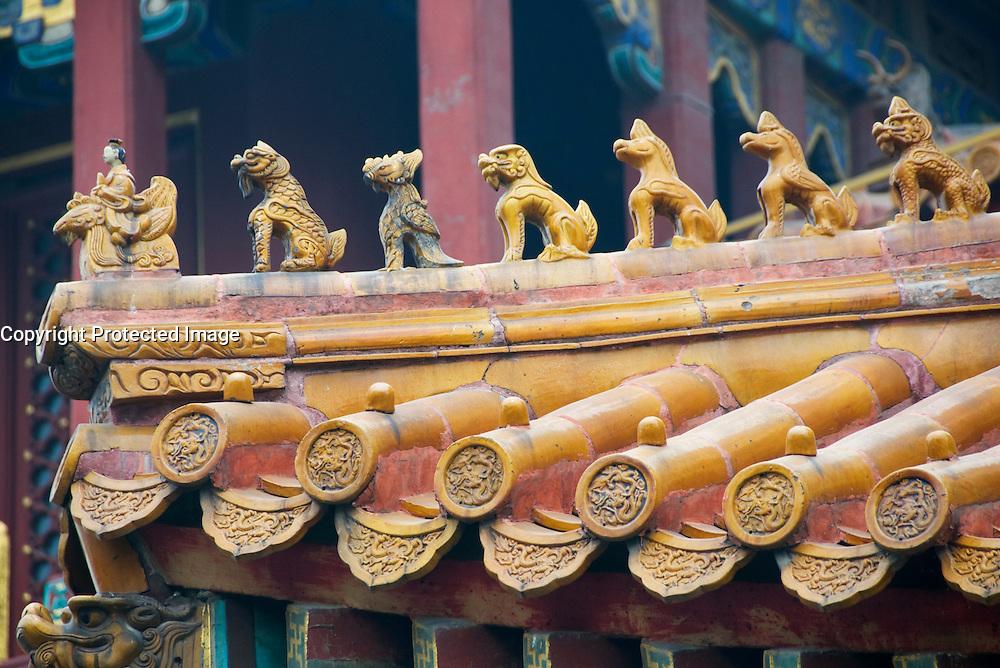 Detaail of ornate ceramic roof at famous Yonghegong Temple in Beijing