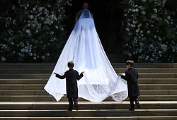 © Licensed to London News Pictures. 19/05/2018. London, UK.   Meghan Markle, The Duchess of Sussex wearing a veil as she arrives at St George's Chapel in Windsor Castle for her wedding ceremony to PRINCE HARRY, Duke of Sussex. . Photo credit: LNP