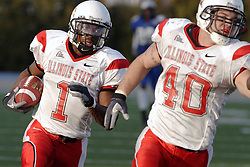 25 November 2006: Cameron Siskowic provides protection for Jesse Caesar as Caesar heads for the end zone after intercepting a Stinson throw. Caesar scored, putting the game out of reach with little time left on the clock. The Redbirds romped the Panthers by a score of 24-13.&#xD;This game was a 1st round NCAA Division 1 Playoff held at O'Brien Stadium on the campus of Eastern Illinois University in Charleston Illinois.<br />