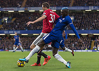 Football - 2017 / 2018 Premier League - Chelsea vs Manchester United<br /> <br /> Tiemoue Bakayoko (Chelsea FC)  times his tackle from behind perfectly to make contact with the ball at Stamford Bridge <br /> <br /> COLORSPORT/DANIEL BEARHAM