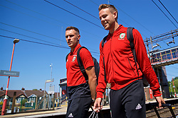 RUNCORN, ENGLAND - Tuesday, May 22, 2018: Wales' Aaron Ramsey and Chris Gunter at Runcorn Station as the squad travel by train as they head to Heathrow for a flight to Los Angeles ahead of the international friendly match against Mexico. (Pic by David Rawcliffe/Propaganda)