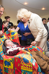 In the image - The Duchess meeting Oliver Samways 6 yrs.<br /> HRH The Duchess of Cornwall, Patron of Helen & Douglas House Hospice visits Douglas House to celebrate their 10th Anniversary. The Hospice cares for children and young adults with life shortening conditions, United Kingdom, Friday, 9th May 2014. Picture by i-Images