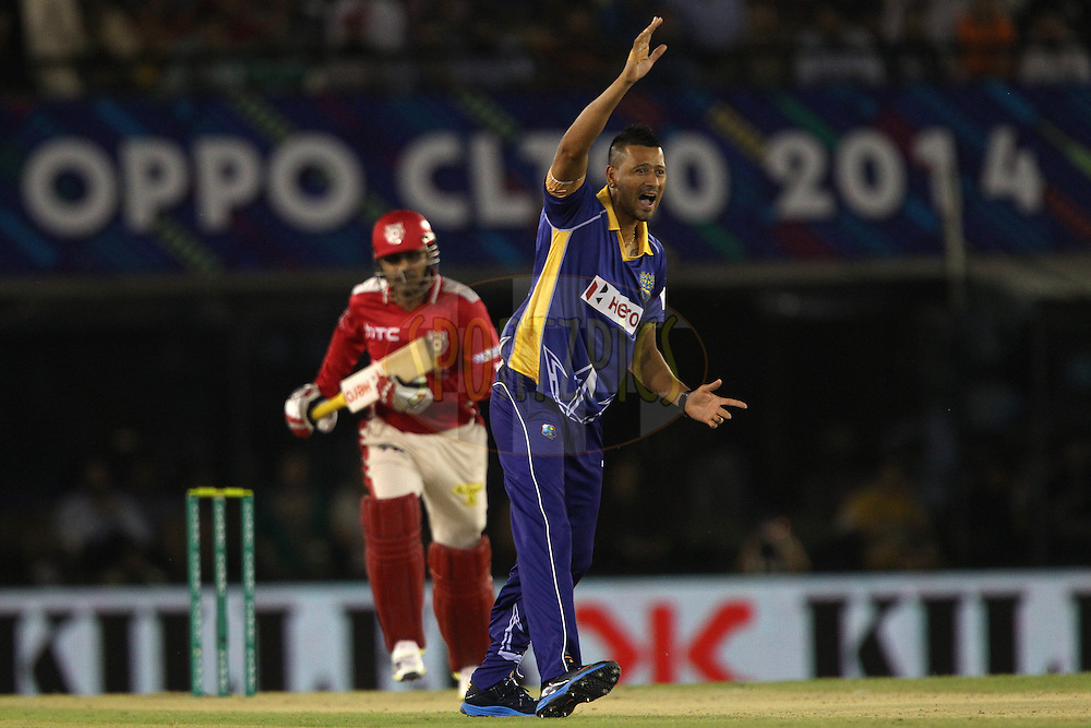 Rayad EMRIT (Captain) of the Barbados Tridents appeals for the wicket of Virender SEHWAG of the Kings XI Punjab  during match 5 of the Oppo Champions League Twenty20 between the Kings XI Punjab and the Barbados Tridents held at the Punjab Cricket Association Stadium, Mohali, India on the 20th September 2014<br /> <br /> Photo by:  Ron Gaunt / Sportzpics/ CLT20<br /> <br /> <br /> Image use is subject to the terms and conditions as laid out by the BCCI/ CLT20.  The terms and conditions can be downloaded here:<br /> <br /> http://sportzpics.photoshelter.com/gallery/CLT20-Image-Terms-and-Conditions-2014/G0000IfNJn535VPU/C0000QhhKadWcjYs