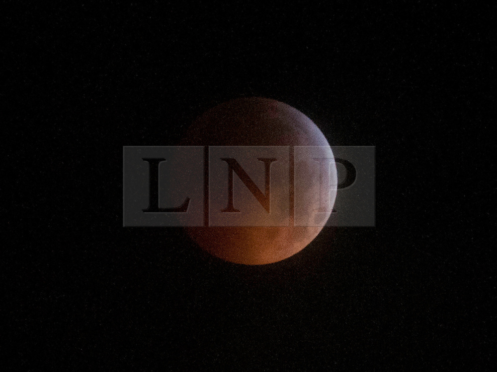 © under license to London News Pictures.  The moon in almost total shadow as seen from New Paltz, New York, USA. Photo credit should read Michael Graae/London News Pictures