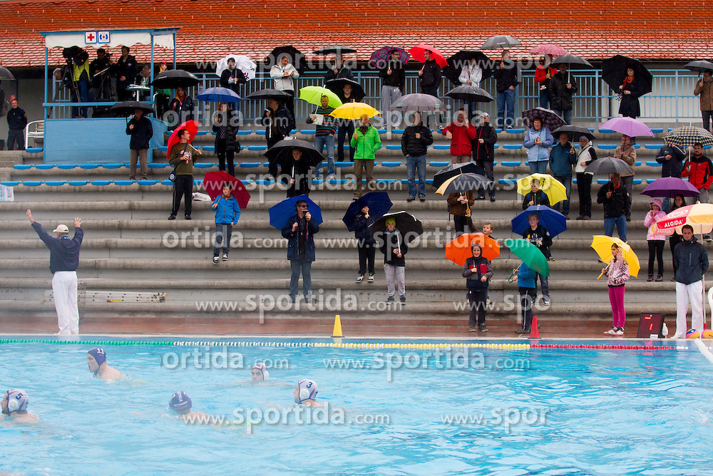 Spectators in rain during water polo match between National Teams of Slovenia and France in first Round of Qualifications for European Championship on May 31, 2013 in Kranj Pool, Slovenia. (Photo By Vid Ponikvar / Sportida)