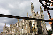 "Local scaffolding and the exterior of King's College Cambridge. King's College is a constituent college of the University of Cambridge, England. The college's full name is ""The King's College of our Lady and Saint Nicholas in Cambridge"", but it is usually referred to simply as ""King's"" within the University. The college was founded in 1441 by King Henry VI, soon after its sister college in Eton. However, the King's plans for the college were disrupted by the civil war and resultant scarcity of funds, and his eventual deposition. Little progress was made on the project until in 1508 King Henry VII began to take an interest in the college, most likely as a political move to legitimise his new position. The building of the college's chapel, begun in 1446, was finally finished in 1544 during the reign of King Henry VIII. King's College Chapel is regarded as one of the greatest examples of late Gothic English architecture. It has the world's largest fan-vault, and the chapel's stained-glass windows and wooden chancel screen are considered some of the finest from their era. The building is seen as emblematic of Cambridge. The chapel's choir, composed of male students at King's and choristers from the nearby King's College School, is one of the most accomplished and renowned in the world. Every year on Christmas Eve the Festival of Nine Lessons and Carols (a service created by a Dean of King's especially for the college) is broadcast from the chapel to millions of listeners worldwide."