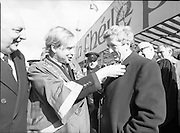St Patrick's Day Parade.1982.17/03/1982.03.17.1982.17th March 1982..The Lord Mayor watched by Mr Stafford affixes shamrock to the coat of his namesake, the former Taoiseach, Mr Garret Fitzgerald.