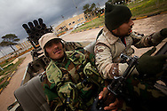 Members of newly formed community militias drive a technical in Benghazi on Feb. 26, 2011.