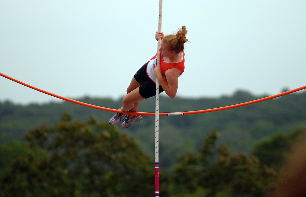 Mahwah, NJ / 2010 - Pascack Hills' Danielle Wankmullen gets temporarily stuck on top of the pole vault bar while competing in the North 1, Group 2 and 3 sectional track championships at Mahwah High School. Photo by Mike Roy / Special to The Bergen Record