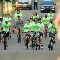 Riders with the Downtown Tupelo Bike Gang make their way west on Clark Blvd as they ride through downtown Tupelo on Wednesday night.