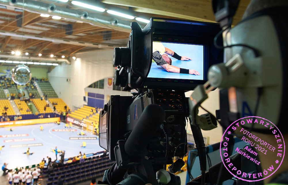 Cameraman Marek Borkowski while TV broadcast production by Multiproduction during handball match on October 12, 2014 in Kielce Poland<br /> <br /> Picture also available in RAW (NEF) or TIFF format on special request.<br /> <br /> For editorial use only. Any commercial or promotional use requires permission.<br /> <br /> Mandatory credit:<br /> Photo by &copy; Adam Nurkiewicz / Mediasport