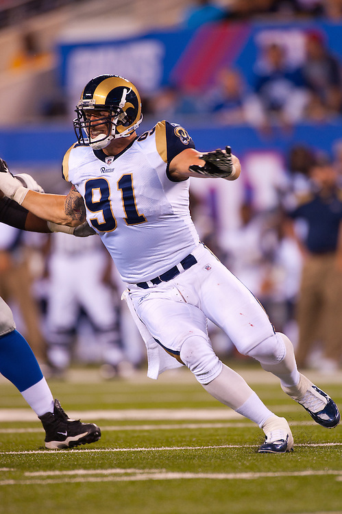 EAST RUTHERFORD, NJ - SEPTEMBER 19: Chris Long #91 of the St. Louis Rams rushes the passer during the game against the New York Giants on September 19, 2011 at MetLife Stadium in East Rutherford, New Jersey.The Giants defeated the Rams 28 to 16. (Photo by Rob Tringali) *** Local Caption *** Chris Long