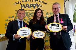 © Licensed to London News Pictures. 24/07/2018. Llanelwedd, Powys, UK. (Visit to Dogs Trust stall) Michael Gove MP, Secretary of State for Environment, Food and Rural Affairs, and Alun Cairns MP, Secretary of State for Wales, visit the Royal Welsh Agricultural Show. The Royal Welsh Agricultural Show is hailed as the largest & most prestigious event of its kind in Europe. In excess of 200,000 visitors are expected this week over the four day show period. The first ever show was at Aberystwyth in 1904 and attracted 442 livestock entries. Photo credit: Graham M. Lawrence/LNP
