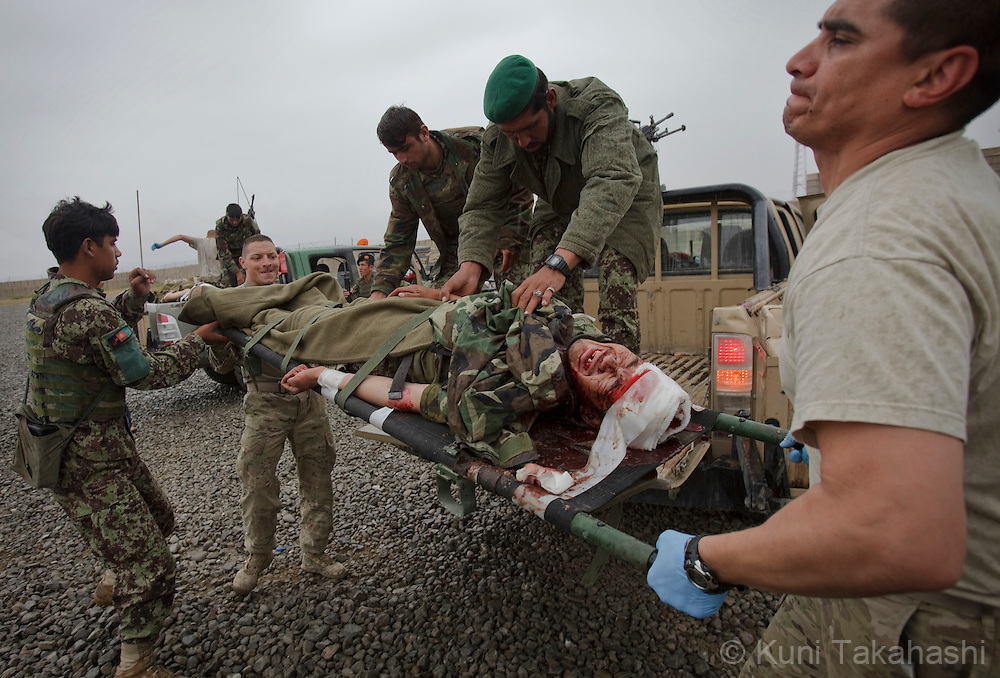 Soldiers of Apache Company 2-28 Infantry help evacuate injured Afghan Army soldier in Mata Khan in Paktika Province in Afghanistan on Sep 1, 2011. Three injured Afghan soldiers were brought to the Combat Out Post after their truck allegedly crashed..(Photo by Kuni Takahashi) .