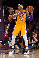 17 January 2013: Center (12) Dwight Howard of the Los Angeles Lakers looks to pass while being guarded by (1) Chris Bosh of the Miami Heat during the second half of the Heat's 99-90 victory over the Lakers at the STAPLES Center in Los Angeles, CA.