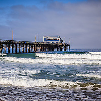 Photo of Newport Beach Pier in Orange County California. Newport Pier is on Balboa Peninsula and is a popular destination for locals and tourists. Newport Beach is a wealthy beach community along the Pacific Ocean in Orange County Southern California. Photo is high resolution and was taken in 2012.