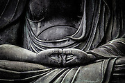 """Detail of a Buddha statue in Sensoji temple, Asakusa. The thumbs in this meditation position are straight forming """"neither mountain nor valley"""""""