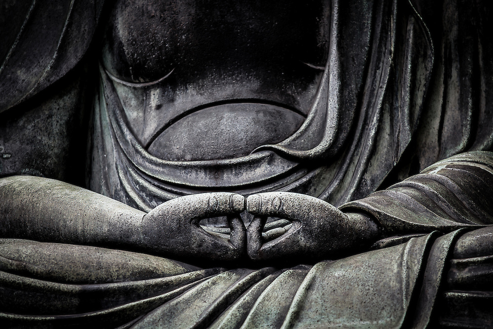 "Detail of a Buddha statue in Sensoji temple, Asakusa. The thumbs in this meditation position are straight forming ""neither mountain nor valley"""