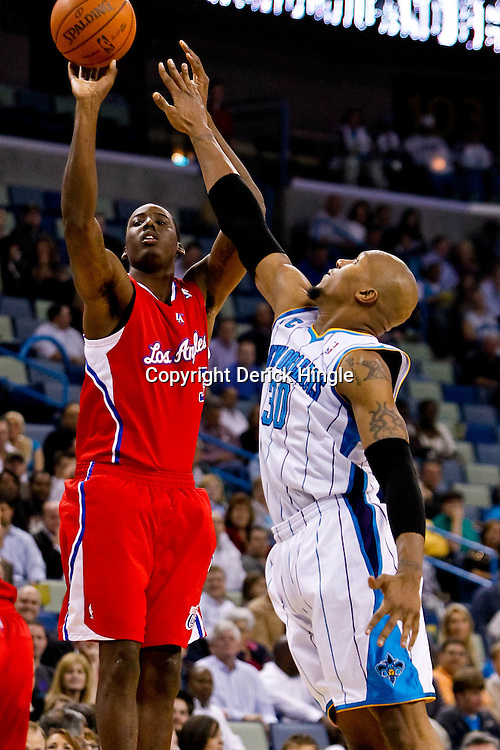 November 9, 2010; New Orleans, LA, USA; Los Angeles Clippers small forward Al-Farouq Aminu (3) shoots over New Orleans Hornets power forward David West (30) during the first half at the New Orleans Arena. Mandatory Credit: Derick E. Hingle