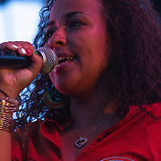 Chandra Pitts addresses the audience during The 19th Annual Bob Marley People's Festival Saturday, July 27, 2013, at Tubman-Garrett Riverfront Park in Wilmington Delaware.