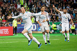 Gareth Bale of Real Madrid, Cristiano Ronaldo and Karim Benzema of Real Madrid  celebrate after Bale scored first goal during the UEFA Champions League final football match between Liverpool and Real Madrid at the Olympic Stadium in Kiev, Ukraine on May 26, 2018.Photo by Sandi Fiser / Sportida