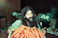 Pierre Robert pealing carrots at the Moody Blues concert while working as a roadie at the Philadelphia Spectrum October 10, 1986 in Philadelphia, Pennsylvania. -- (Photo by William Thomas Cain/Cain Images for WMMR).