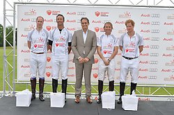 Left to right, HRH THE DUKE OF CAMBRIDGE, JOHN PAUL CLARKIN, ANDRE KONSBRUCK Director of Audi UK, MARK TOMLINSON and HRH PRINCE HARRY at the Audi Polo Challenge at Coworth Park, Blacknest Road, Ascot, Berkshire on 31st May 2015.