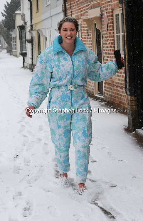 Carmel Fox a visitor from Australia, gets her first taste of snow in the village of Brasted, Kent, Friday, 18th January 2013.  Photo by: Stephen Lock / i-Images