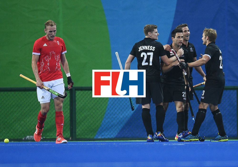 New Zealand's Kane Russell (3R) celebrates scoring a goal with teammates during the men's field hockey Britain vs New Zealand match of the Rio 2016 Olympics Games at the Olympic Hockey Centre in Rio de Janeiro on August, 7 2016. / AFP / MANAN VATSYAYANA        (Photo credit should read MANAN VATSYAYANA/AFP/Getty Images)