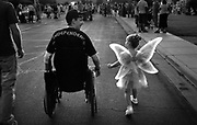Brent takes his daughter, Celeste, 4, who was dressed as Tinkerbelle, to a Halloween block party. Brent Bretz, a soldier who was seriously injured by an IED (improvised explosive device) in Iraq.