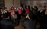 Patients perform a song interacting with each other as part of the therapy to cure mental conditions inside Vila Rosa Residential Open Unit for people with mental health conditions in Yinqing district, Beijing, China. Photo by Xaume Olleros