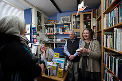 UK ENGLAND FOWEY 19FEB15 - Ann Willmore, proprietor of Bookends of Fowey, Cornwall, England, a specialist bookshop on literature by famous English novelist Daphne Du Maurier with biographer Tatiana De Rosnay. Fowey, a small fishing and harbour village was the living place of famous English writer Daphne Du Maurier and many of her novels are based here.<br /> <br /> jre/Photo by Jiri Rezac<br /> <br /> &copy; Jiri Rezac 2015
