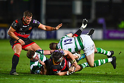 Dragons' James Benjamin is tackled by Newcastle Falcons' Tom Penny<br /> <br /> Photographer Craig Thomas/Replay Images<br /> <br /> EPCR Champions Cup Round 4 - Newport Gwent Dragons v Newcastle Falcons - Friday 15th December 2017 - Rodney Parade - Newport<br /> <br /> World Copyright © 2017 Replay Images. All rights reserved. info@replayimages.co.uk - www.replayimages.co.uk