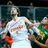 06 August 2012: Spain Pau Gasol vies for the rebound with Anderson Varejao during the 88-82 Team Brazil victory over Team Spain, during the men's basketball preliminary, at the Basketball Arena, in London, Great Britain.