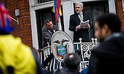 UNITED KINGDOM, London: 5 February 2016. WikiLeaks founder Julian Assange addresses the media holding a printed report of the judgement of the UN's Working Group on Arbitrary Detention on his case from the balcony of the Ecuadorian embassy in central London.  Pic by Andrew Cowie / Story Picture Agency
