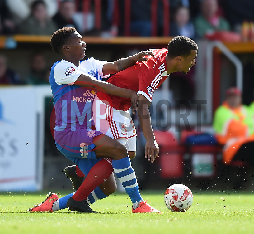 Peterborough United's Kgosi Ntlhe tussles with Swindon Town's Nathan Byrne - Photo mandatory by-line: Paul Knight/JMP - Mobile: 07966 386802 - 11/04/2015 - SPORT - Football - Swindon - The County Ground - Swindon Town v Peterborough United - Sky Bet League One