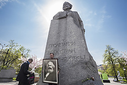 May 5, 2018 - Moscow, Moscow, Russia - Man holds a huge photo of Karl Marx under his statue during the celebrations of 200th anniversary of his birth in Moscow. (Credit Image: © Celestino Arce/NurPhoto via ZUMA Press)