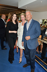 Left to right, NIGELLA LAWSON, CHRISSIE GAGOSIAN and LARRY GAGOSIAN at an Evening at The River Cafe in aid of the NSPCC held at The River Cafe, Thames Wharf, Rainville Road, London on 19th June 2016
