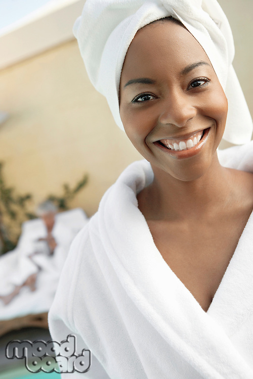 Woman at spa with towel round head half length