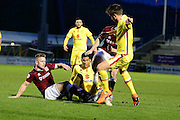 Northampton and MK Dons players battle for the ball during  the The FA Cup match between Northampton Town and Milton Keynes Dons at Sixfields Stadium, Northampton, England on 9 January 2016. Photo by Dennis Goodwin.