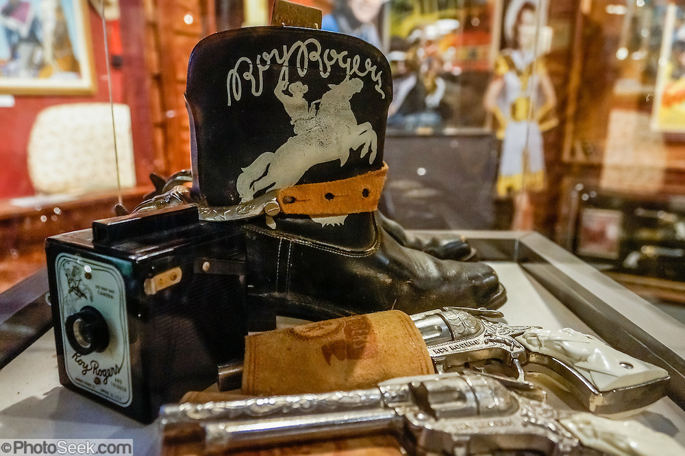 "Boots and pistols used by Roy Rogers. Roy Rogers (born Leonard Franklin Slye in 1911, died in 1998) was an American singer and cowboy actor who was one of the most popular Western stars of his era. Known as the ""King of the Cowboys"", he appeared in over 100 films and numerous radio and television episodes of The Roy Rogers Show. He often appeared with his wife Dale Evans, his golden palomino Trigger, and his German Shepherd dog Bullet. His show ran on radio for nine years before moving to television from 1951 through 1957. His productions usually featured a sidekick, often Pat Brady, Andy Devine, or George ""Gabby"" Hayes. In his later years, Rogers lent his name to the Roy Rogers Restaurants franchise chain. Fans of movies and television shouldn't miss the Museum of Western Film History, 701 S. Main Street, Lone Pine, California, 93545, USA. (Formerly called the Beverly and Jim Rogers Museum of Lone Pine Film History.) Web site: www.lonepinefilmhistorymuseum.org"