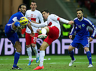 (R) Robert Lewandowski fights for the ball with (L) Fabio Vitaioli of San Marino during the 2014 World Cup Qualifying Group H soccer match between Poland and San Marino at National Stadium in Warsaw on March 26, 2013...Poland, Warsaw, March 26, 2013...Picture also available in RAW (NEF) or TIFF format on special request...For editorial use only. Any commercial or promotional use requires permission...Photo by © Adam Nurkiewicz / Mediasport