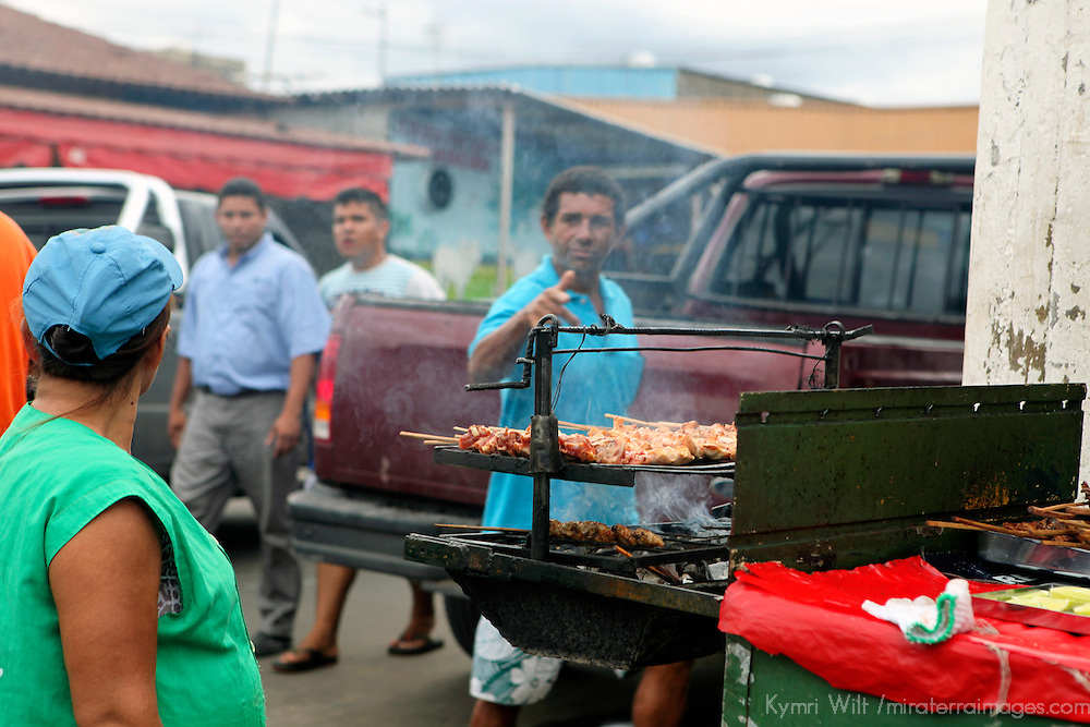 South America, Brazil, Manaus. Stret vendor of Manaus selling grilled meats.