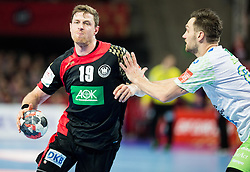 Martin Strobel of Germany vs Luka Zvizej of Slovenia during handball match between National teams of Germany and Slovenia on Day 6 in Preliminary Round of Men's EHF EURO 2016, on January 20, 2016 in Centennial Hall, Wroclaw, Poland. Photo by Vid Ponikvar / Sportida