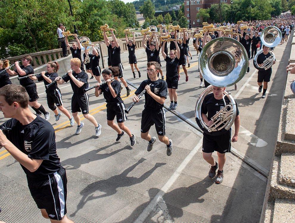The Marching 110 leads first year students up the Richland Avenue bridge following the 2019 First Year Convocation. Photo by Hannah Ruhoff